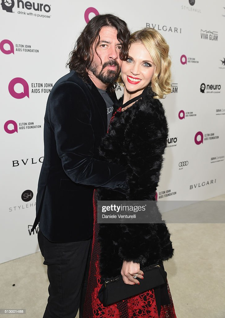 Musician Dave Grohl (L) and Jordyn Blum attend Bulgari at the 24th Annual Elton John AIDS Foundation's Oscar Viewing Party at The City of West Hollywood Park on February 28, 2016 in West Hollywood, California.