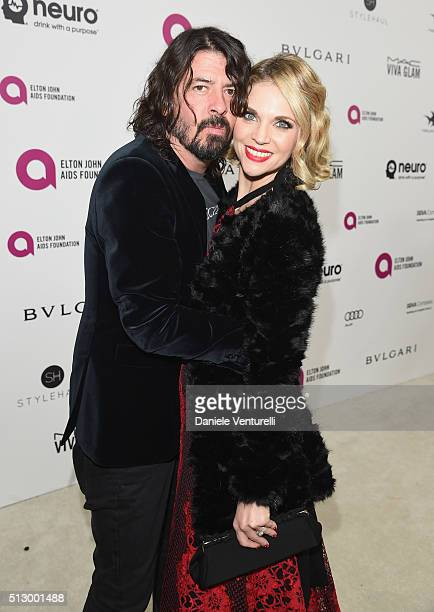 Musician Dave Grohl and Jordyn Blum attend Bulgari at the 24th Annual Elton John AIDS Foundation's Oscar Viewing Party at The City of West Hollywood...