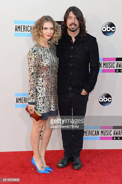 Musician Dave Grohl and Jordyn Blum attend the 2013 American Music Awards at Nokia Theatre LA Live on November 24 2013 in Los Angeles California