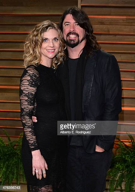 Musician Dave Grohl and Jordyn Blum attend the 2014 Vanity Fair Oscar Party hosted by Graydon Carter on March 2 2014 in West Hollywood California