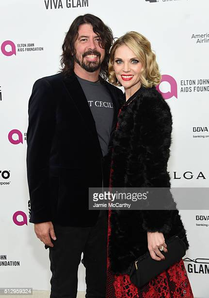 Musician Dave Grohl and Jordyn Blum attend the 24th Annual Elton John AIDS Foundation's Oscar Viewing Party at The City of West Hollywood Park on...