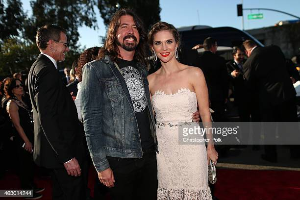 Musician Dave Grohl and Jordyn Blum attend The 57th Annual GRAMMY Awards at the STAPLES Center on February 8 2015 in Los Angeles California