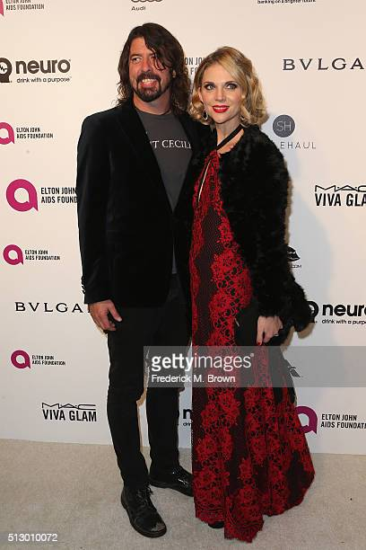 Musician Dave Grohl and Jordyn Blum attends the 24th Annual Elton John AIDS Foundation's Oscar Viewing Party on February 28 2016 in West Hollywood...