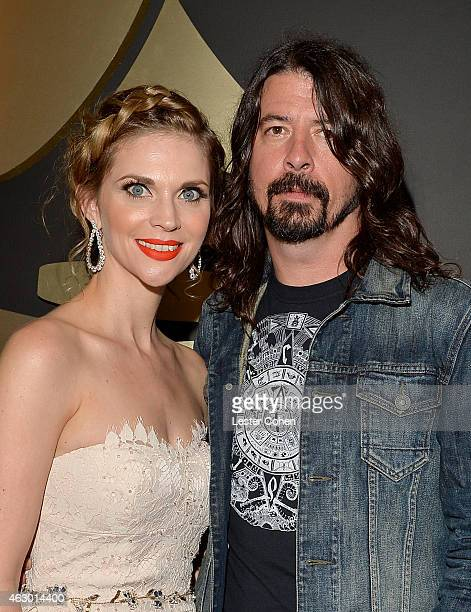 Musician Dave Grohl and Jordyn Blum attends The 57th Annual GRAMMY Awards at the STAPLES Center on February 8 2015 in Los Angeles California