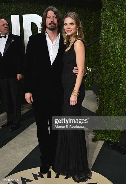 Musician Dave Grohl and Jordyn Blum Grohl arrive at the 2013 Vanity Fair Oscar Party hosted by Graydon Carter at Sunset Tower on February 24 2013 in...