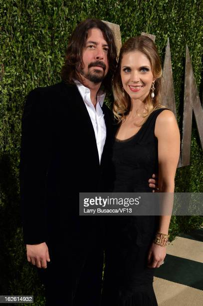 Musician Dave Grohl and Jordyn Blum Grohl arrive for the 2013 Vanity Fair Oscar Party hosted by Graydon Carter at Sunset Tower on February 24 2013 in...