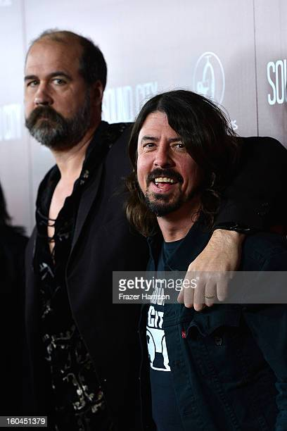 """Musician Dave Grohl and Krist Novoselic arrive at the Premiere Of """"Sound City"""" at ArcLight Cinemas Cinerama Dome on January 31, 2013 in Hollywood,..."""