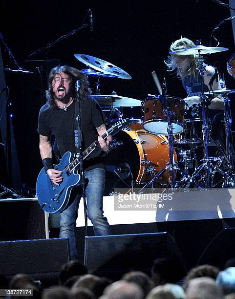 Musician Dave Grohl and Taylor Hawkins of musical group Foo Fighters perform onstage at the 2012 MusiCares Person of the Year Tribute to Paul...