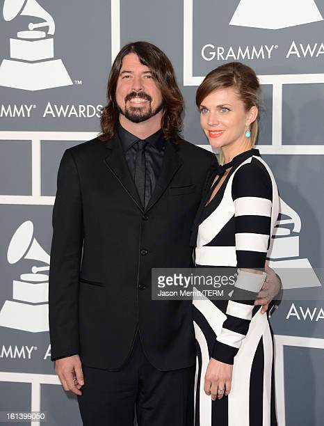 Musician Dave Grohl and wife Jordyn Blum arrive at the 55th Annual GRAMMY Awards at Staples Center on February 10 2013 in Los Angeles California