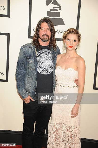 Musician Dave Grohl and wife Jordyn Blum arrive at The 57th Annual GRAMMY Awards held at the Staples Center