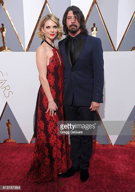 Musician Dave Grohl and wife Jordyn Blum arrive at the 88th Annual Academy Awards at Hollywood Highland Center on February 28 2016 in Hollywood...