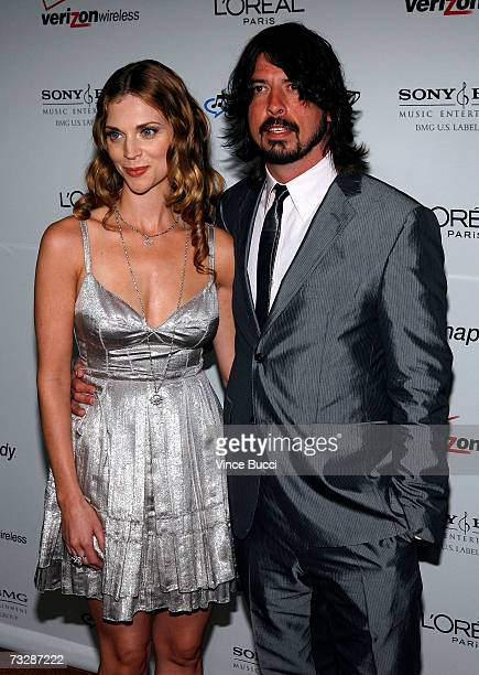 Musician Dave Grohl and wife Jordyn Blum arrives at the Clive Davis preGrammy party held at the Beverly Hilton on February 10 2007 in Beverly Hills...