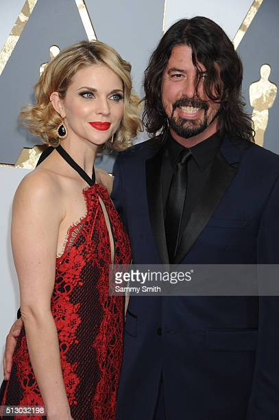 Musician Dave Grohl and wife Jordyn Blum attend the 88th Annual Academy Awards at Hollywood Highland Center on February 28 2016 in Hollywood...