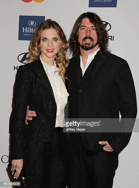 Musician Dave Grohl and wife Jordyn Grohl arrive at the The 55th Annual GRAMMY Awards PreGRAMMY Gala And Salute To Industry Icons Honoring LA Reid at...