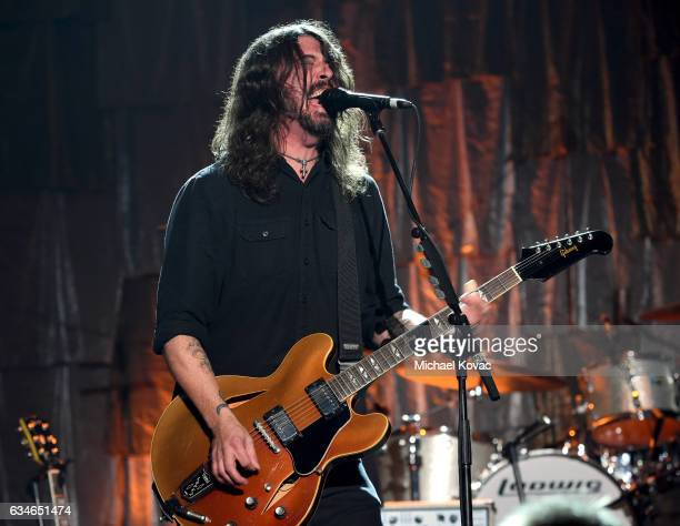 Musician Dave Grohl from the Foo Fighters performs onstage during MusiCares Person of the Year honoring Tom Petty at the Los Angeles Convention...