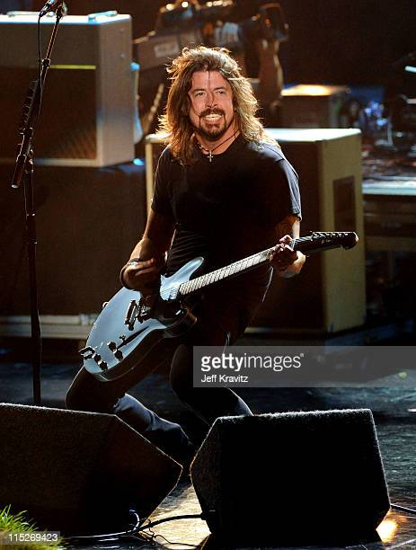 Musician Dave Grohl of Foo Fighters performs onstage during the 2011 MTV Movie Awards at Universal Studios' Gibson Amphitheatre on June 5 2011 in...