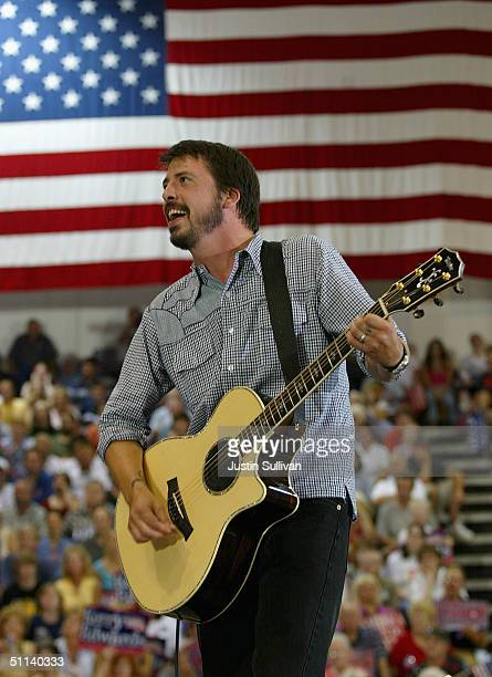 Musician Dave Grohl of the band Foo Fighters plays a song during a rally for democratic presidential candidate US Senator John Kerry August 3 2004 in...