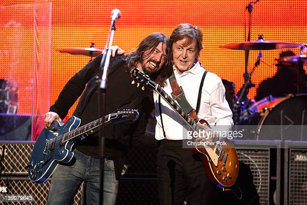 Musician Dave Grohl of the Foo Fighters and honoree Sir Paul McCartney perform onstage during The 2012 MusiCares Person Of The Year Gala Honoring...