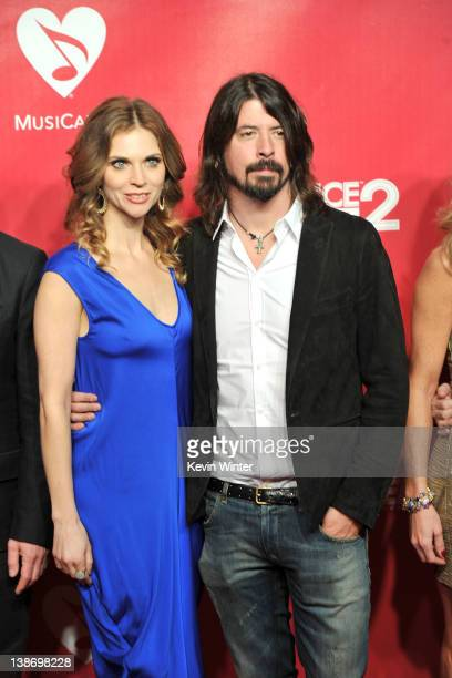 Musician Dave Grohl of the Foo Fighters and wife Jordyn Blum arrive at the 2012 MusiCares Person of the Year Tribute to Paul McCartney held at the...