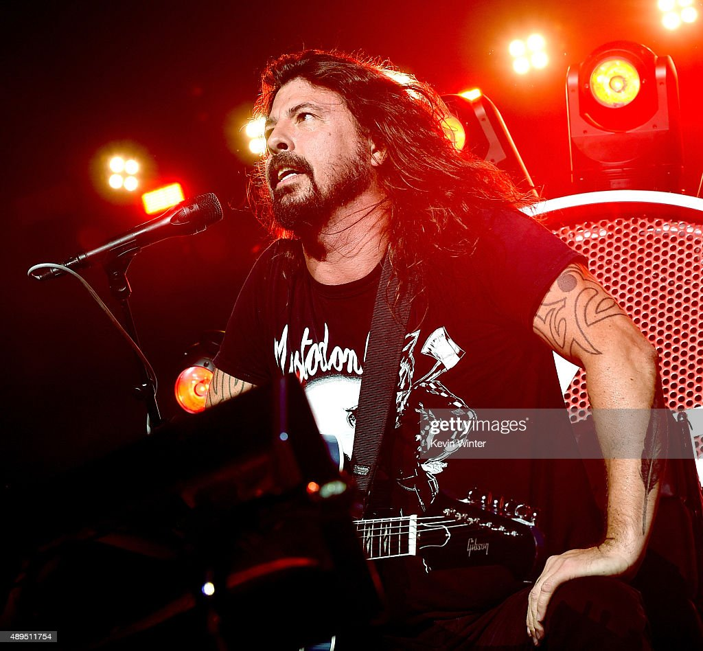 Musician Dave Grohl of the Foo Fighters performs at the Forum on September 21, 2015 in Inglewood, California.