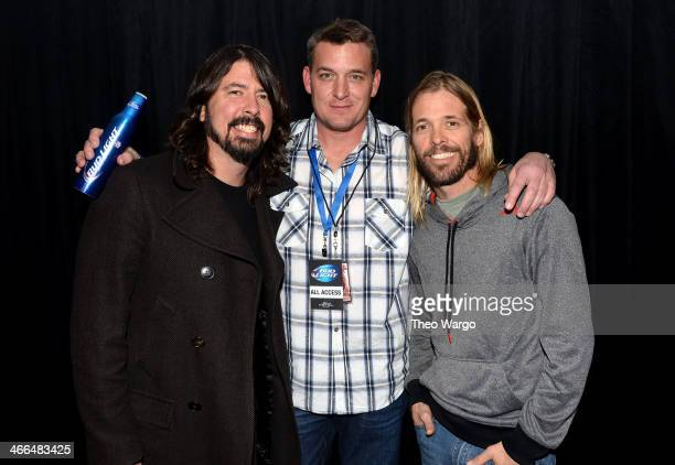 Musician Dave Grohl VP of Sports Entertainment Advertising Production AnheuserBusch Mike Sundet and musician Taylor Hawkins attend the Bud Light Main...