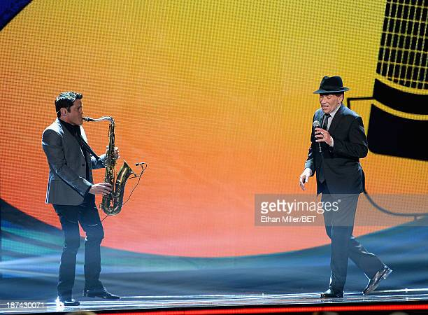 Musician Dave Koz and singer/songwriter Bobby Caldwell perform onstage at the Soul Train Awards 2013 at the Orleans Arena on November 8 2013 in Las...