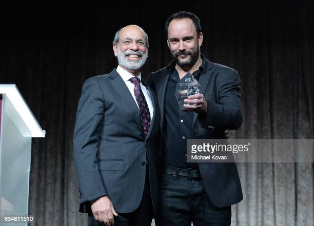 Musician Dave Matthews presents attorney Elliot Groffman with the 2017 ELI Service Award at the Entertainment Law Initiative on February 10 2017 in...