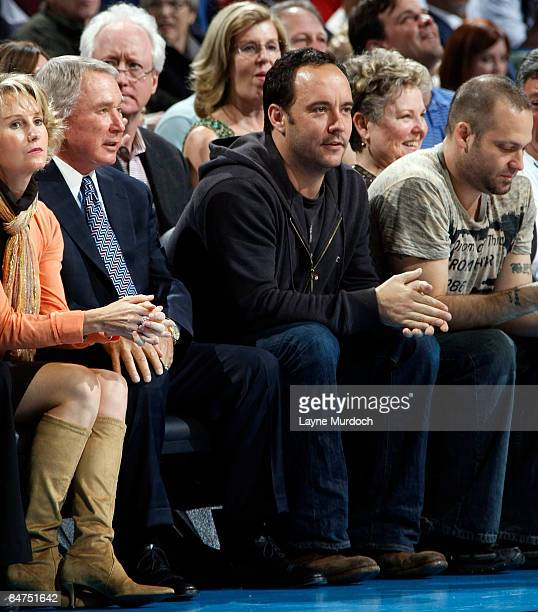 Musician Dave Matthews sits with New Orleans Hornets owner George Shinn and his wife Denise at the Hornets' game against the Boston Celtics on...