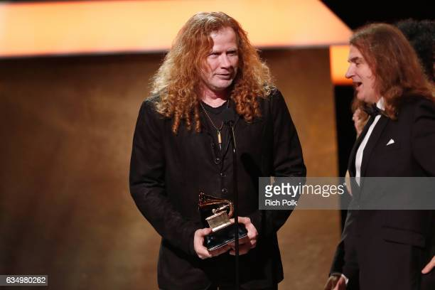 Musician Dave Mustaine and David Ellefson of Megadeth accepts the Best Metal Performance award for 'Dystopia' onstage at the Premiere Ceremony during...