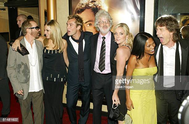 Musician Dave Stewart actors Sienna Miller and Jude Law director Charles Shyer actresses Jane Krakowski and Nia Long and musician Sir Mick Jagger...