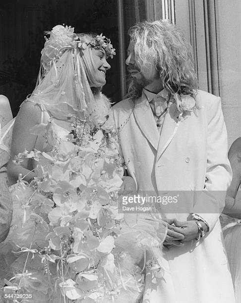 Musician Dave Stewart and his new bride Siobhan Fahey of the band 'Bananarama' outside the church on their wedding day August 1st 1987