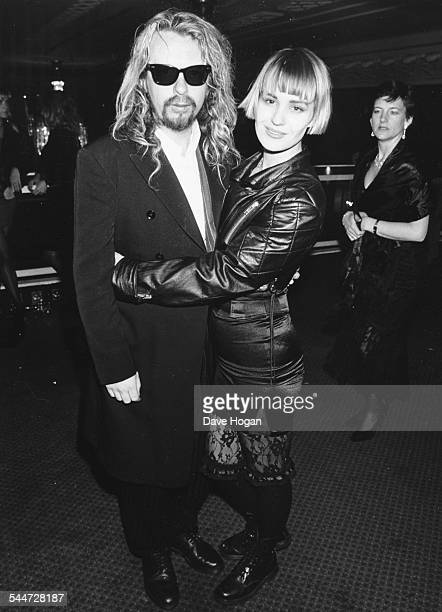 Musician Dave Stewart and his wife Siobhan Fahey of the band 'Bananarama' attending the British Rock Industry Awards London 1988