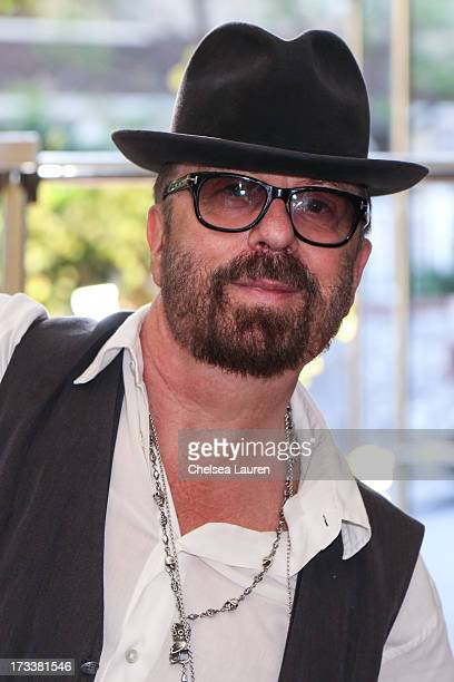 Musician Dave Stewart attends the Dave Stewart Jumpin' Jack Flash The Suicide Blonde photo exhibition at Morrison Hotel Gallery on July 12 2013 in...