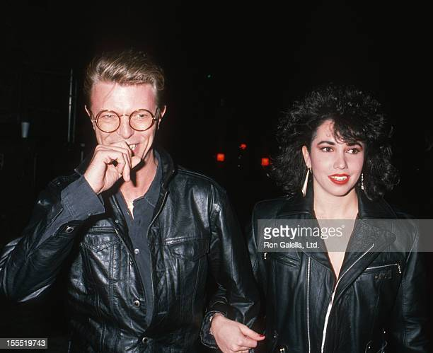 Musician David Bowie and date Melissa Hurley attend the performance of Hurlyburly on December 2, 1988 at the Westwood Theater in Westwood, California.