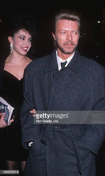 Musician David Bowie and date Melissa Hurley attends the performance of Metamorphosis on March 6, 1989 at the Barrymore Theater in New York City.
