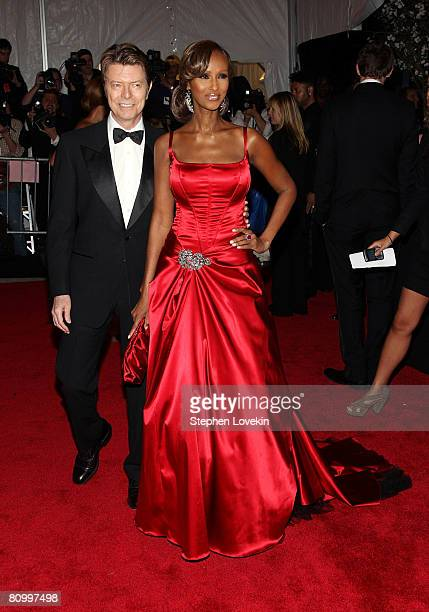 Musician David Bowie and model Iman arrive at the Metropolitan Museum of Art Costume Institute Gala, Superheroes: Fashion and Fantasy, held at the...
