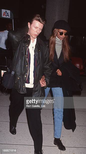 Musician David Bowie and model Iman sighted on January 25 1993 at the Los Angeles International Airport in Los Angeles California