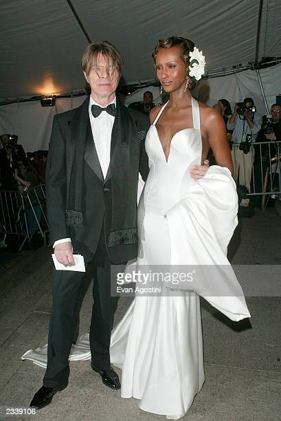 Musician David Bowie and wife model Iman arrive at the Metropolitan Museum of Art Costume Institute Benefit Gala sponsored by Gucci April 28 2003 at...