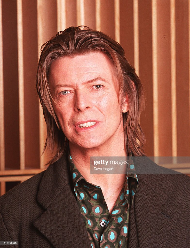 Musician David Bowie appears during a live radio interview with Radio One DJ's Mark and Lard at the Radio One Maida Vale studio in 2001 in London.