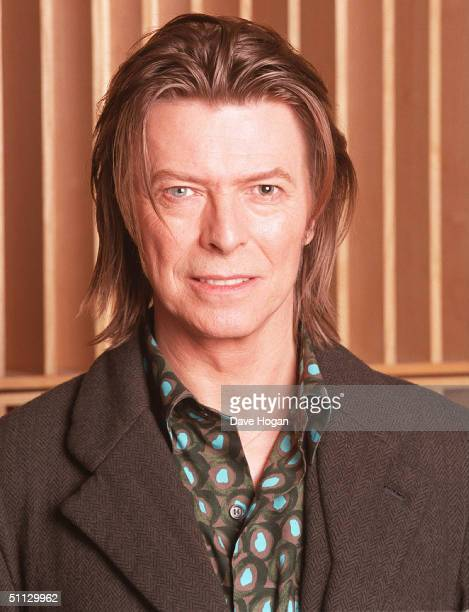 Musician David Bowie appears during a live radio interview with Radio One DJ's Mark and Lard at the Radio One Maida Vale studio in 2001 in London