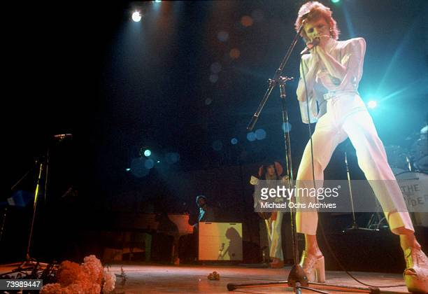 "Musician David Bowie performs onstage during his ""Ziggy Stardust"" era in 1973 in Los Angeles, California."