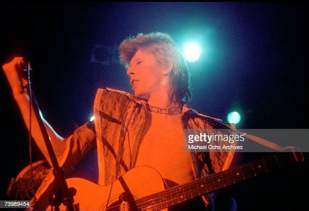 Musician David Bowie performs onstage during his Ziggy Stardust era in 1973 in Los Angeles California