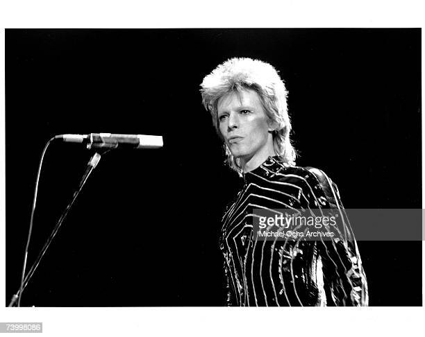 Musician David Bowie performs onstage on March 10, 1973 in Long Beach, California.