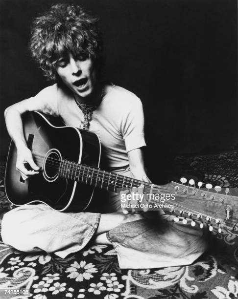 Musician David Bowie plays an acoustic Espana 12string guitar to promote the release of his album Space Oddity in November 1969 in London England