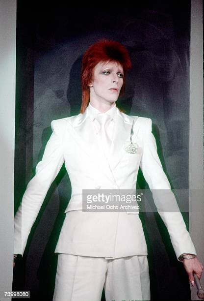 Musician David Bowie wears a white suit in November 1973 in London, England.