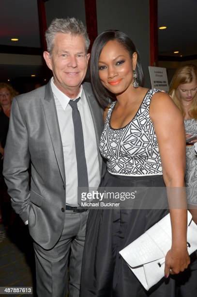 Musician David Foster and Actress Garcelle Beauvais attend the 21st annual Race to Erase MS at the Hyatt Regency Century Plaza on May 2, 2014 in...