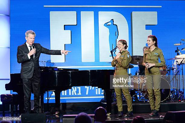 Musician David Foster performs onstage with IDF soldiers during the Friends Of The Israel Defense Forces Western Region Gala at The Beverly Hilton...