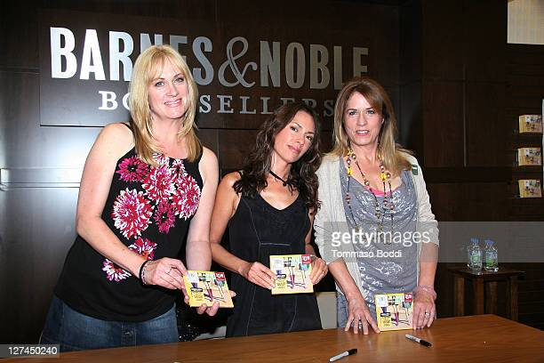 Musician Debbi Peterson Vicki Peterson and Susanna Hoffs of The Bangles sign copies of their CD 'Sweetheart Of The Sun' at Barnes Noble bookstore at...