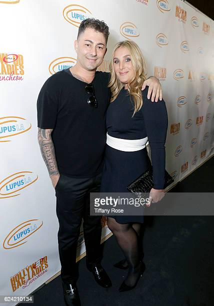 Musician Dennis DeSantis and Honoree Nicole Fogel attend the Hollywood Bag Ladies Luncheon at The Beverly Hilton Hotel on November 18 2016 in Beverly...