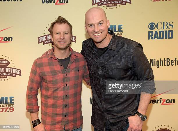 Musician Dierks Bentley and NFL player Matt Hasselbeck pose backstage during CBS Radio's The Night Before at US Airways Center on January 31 2015 in...